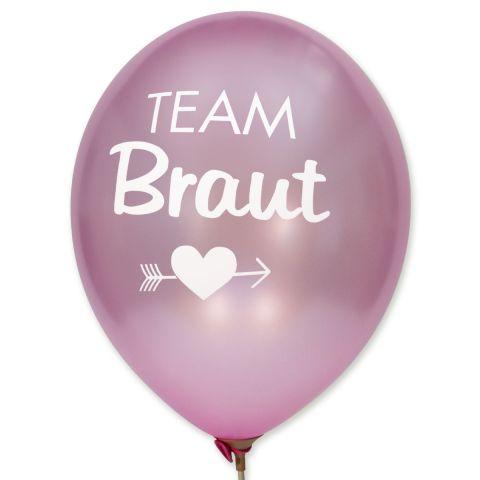 """Rosa metallic Ballons mit weißem Aufdruck """"Team Braut"""" mit Motiv darunter Herz und Pfeil durch."""