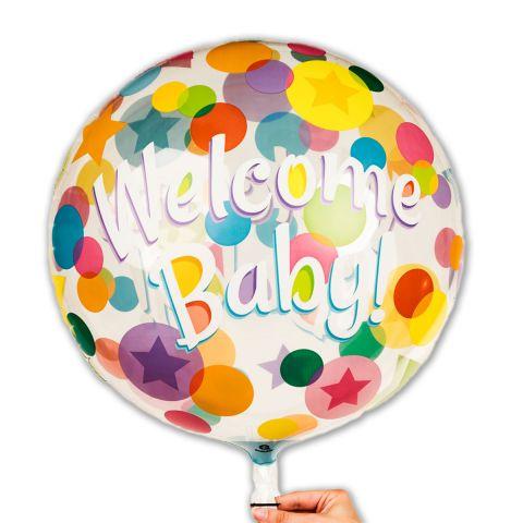 """Runder, flacher Folienballon mit dem Aufdruck """"Welcome Baby"""" und bunten Punkten."""